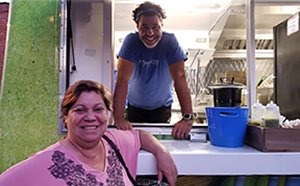 Cristian with his mom a Taste of Brazil Food Truck Event